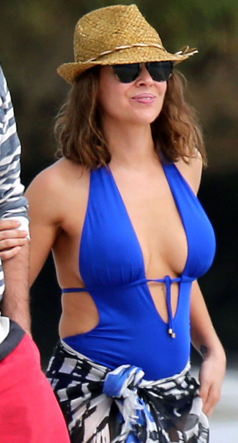 Alyssa Milano In A Blue Swimsuit In Hawaii November 2013