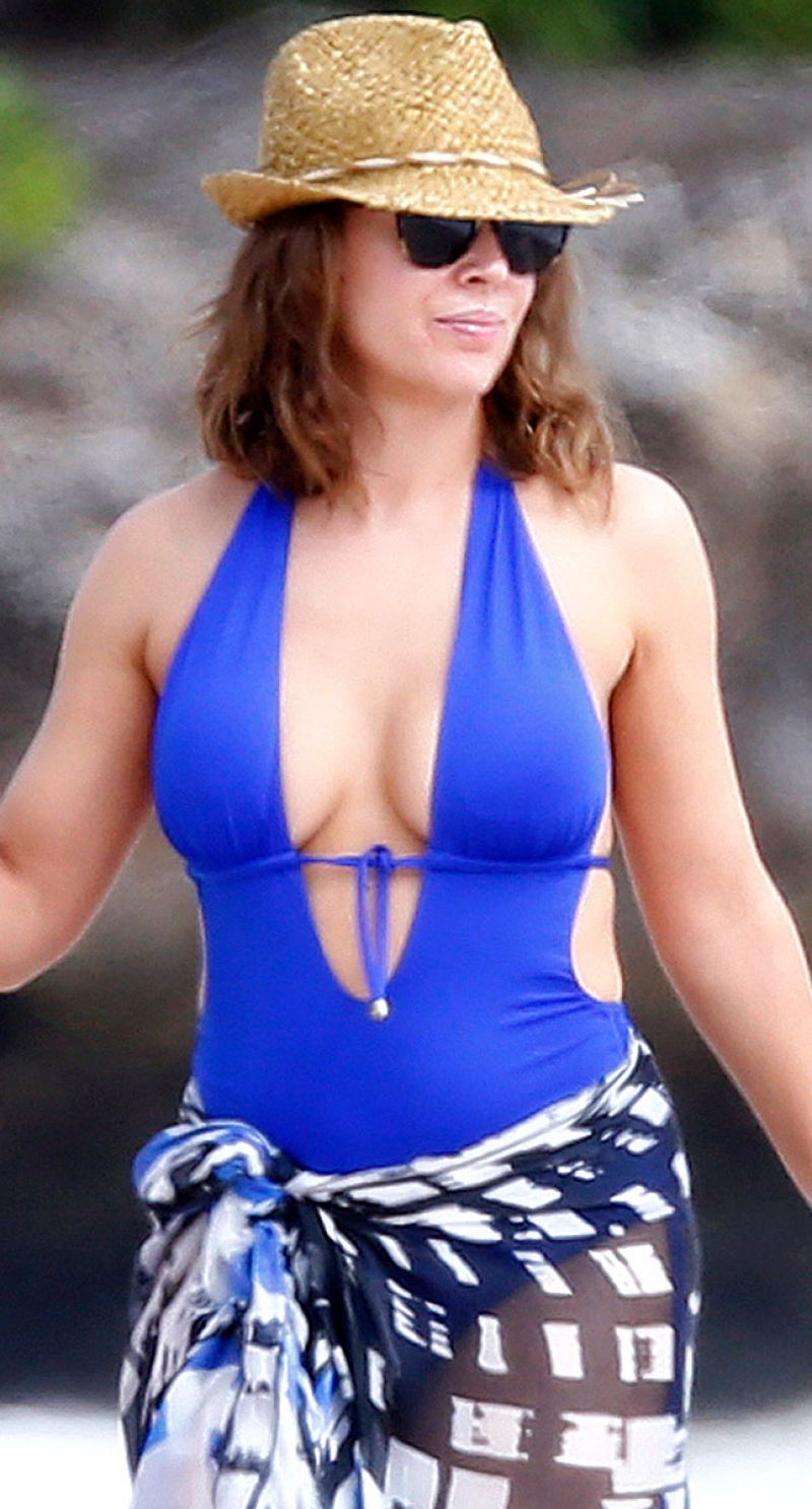 Alyssa Milano In A Blue Swimsuit In Hawaii November 2013