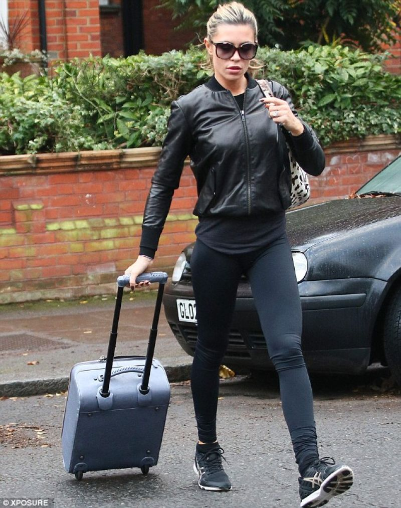 """Abbey Clancy Street Style - in Tight Navy Blue Leggings Leaving """"Strictly Come Dancing judges"""" - December 2013"""