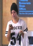 Kaley Cuoco - Gym Style - in a Cropped Black Leggings Leaving the Gym - December 2013