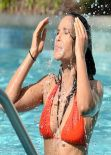 Padma Lakshmi in an Orange Bikini at Her Hotel Pool in Miami - December 2013