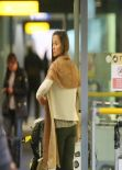 Pippa Middleton Street Style - Arrives at Heathrow Airport - December 2013