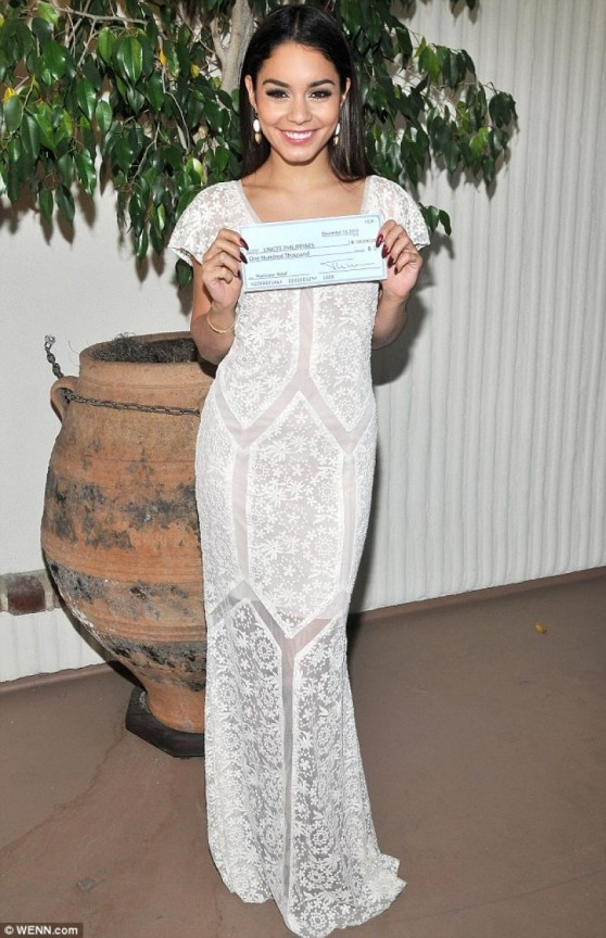 Vanessa Hudgens - Accepting a $100K Relief Sheck on Behalf of UNICEF in Los Angeles - Dec. 2013