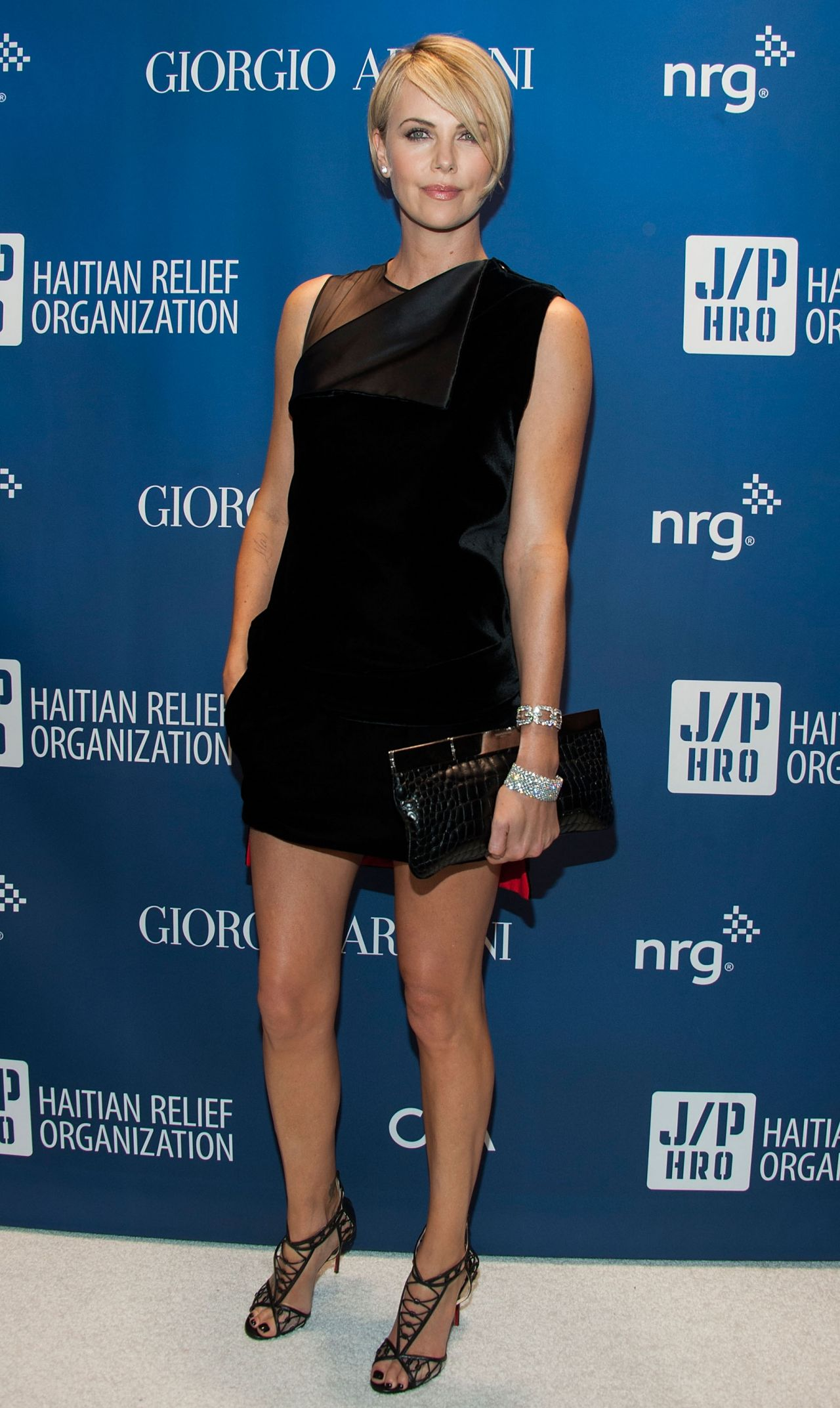 Charlize Theron Wearing Givenchy Dress at Sean Penn & Friends Help Haiti Home Gala, January 2014