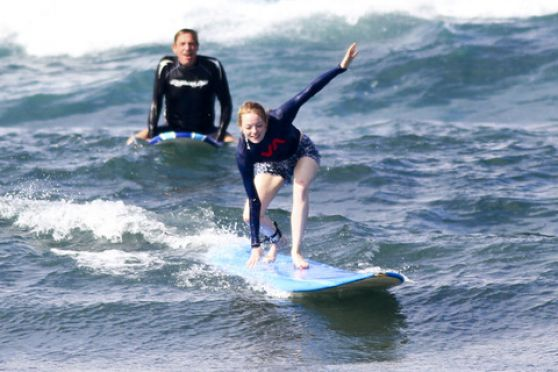 Emma Stone - Surfing in Hawaii - January 2014