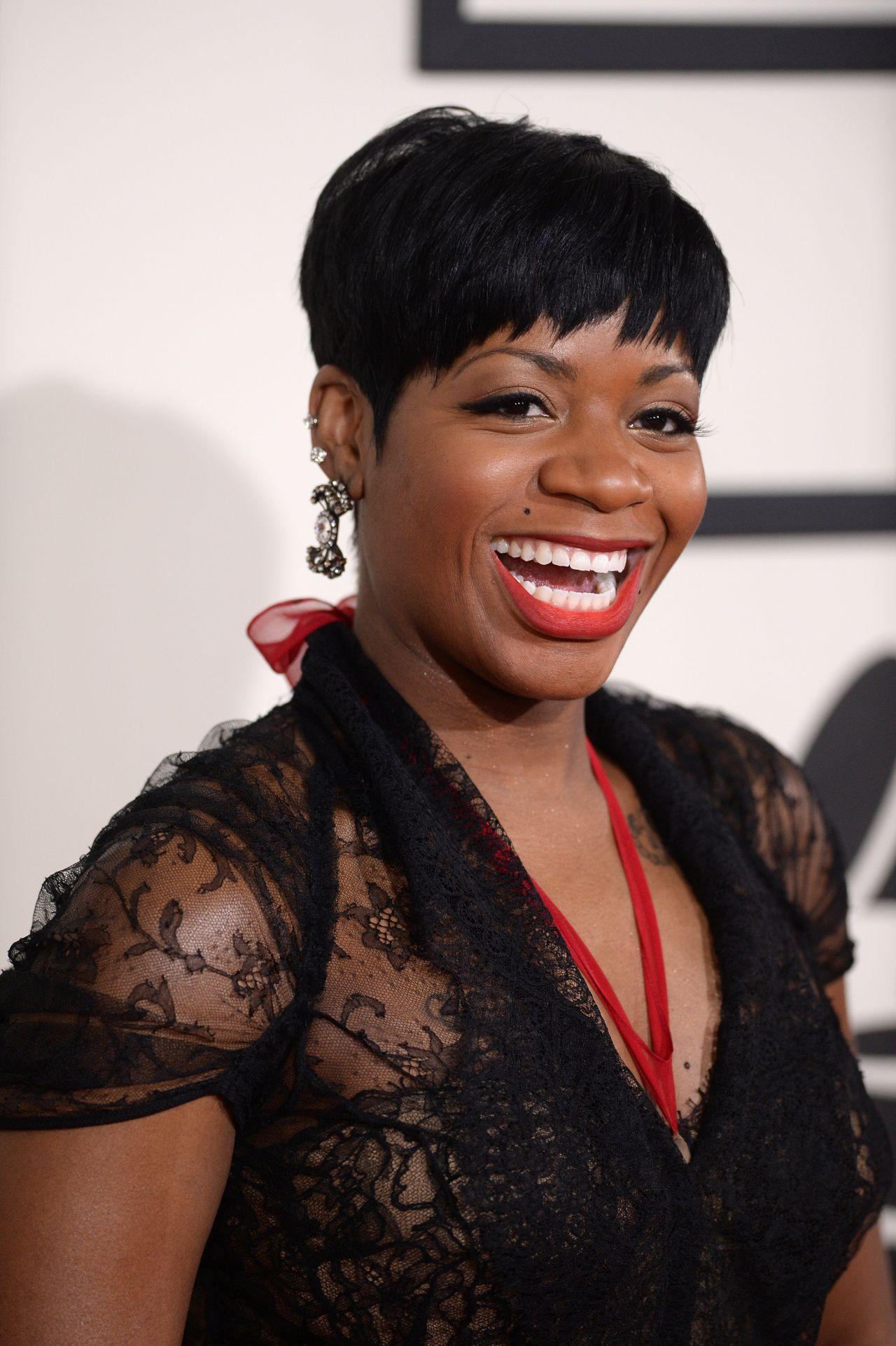 Check Out Fantasia Barrino in Front of a Lavish Car with