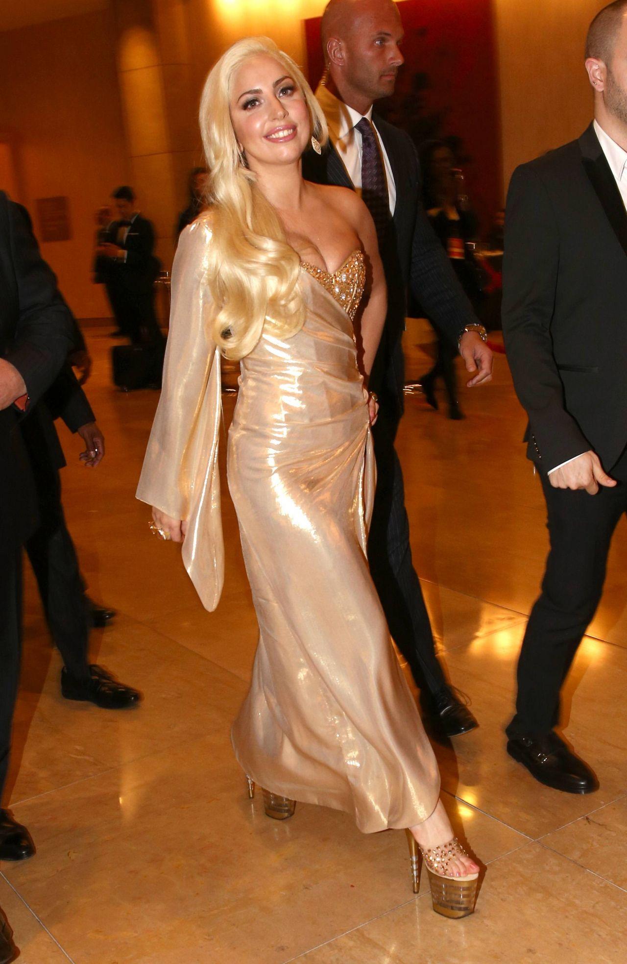 Lady Gaga Wears Perry Meek Bespoke Gold Dress At 2014