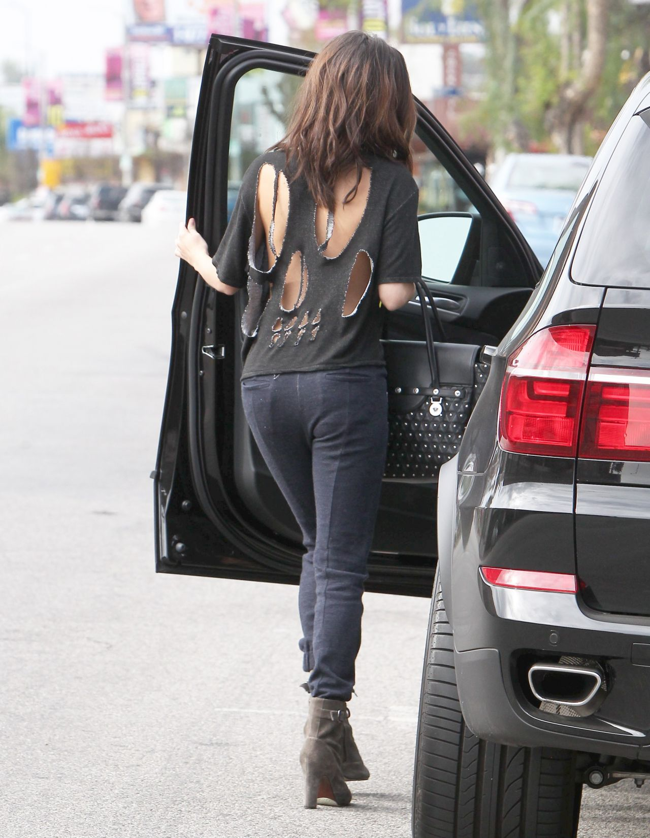 Selena Gomez Street Style - in a Shredded Shirt - January 2014