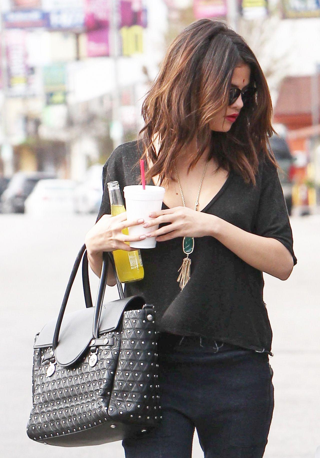 Selena gomez street style in a shredded shirt january 2014 - Photo selena gomez 2014 ...