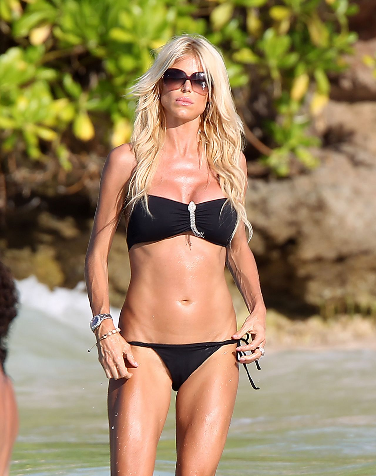 With her slim body and Dark blond hairtype without bra (cup size 36D) on the beach in bikini