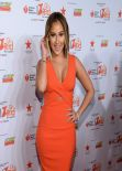 Adrienne Bailon - Red Dress Collection Fashion Show 2014