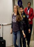 Alicia Silverstone in Jeans at LAX Airport - February 2014