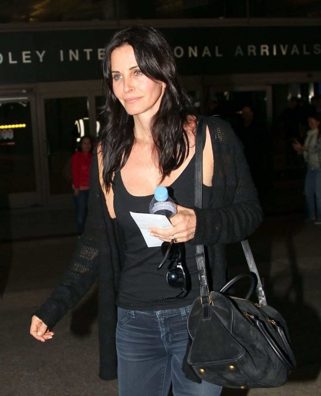 Courteney Cox in Jeans - At LAX Airport, Feb. 2014