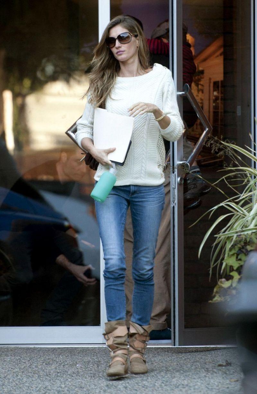gisele bundchen in jeans leaving an office building in