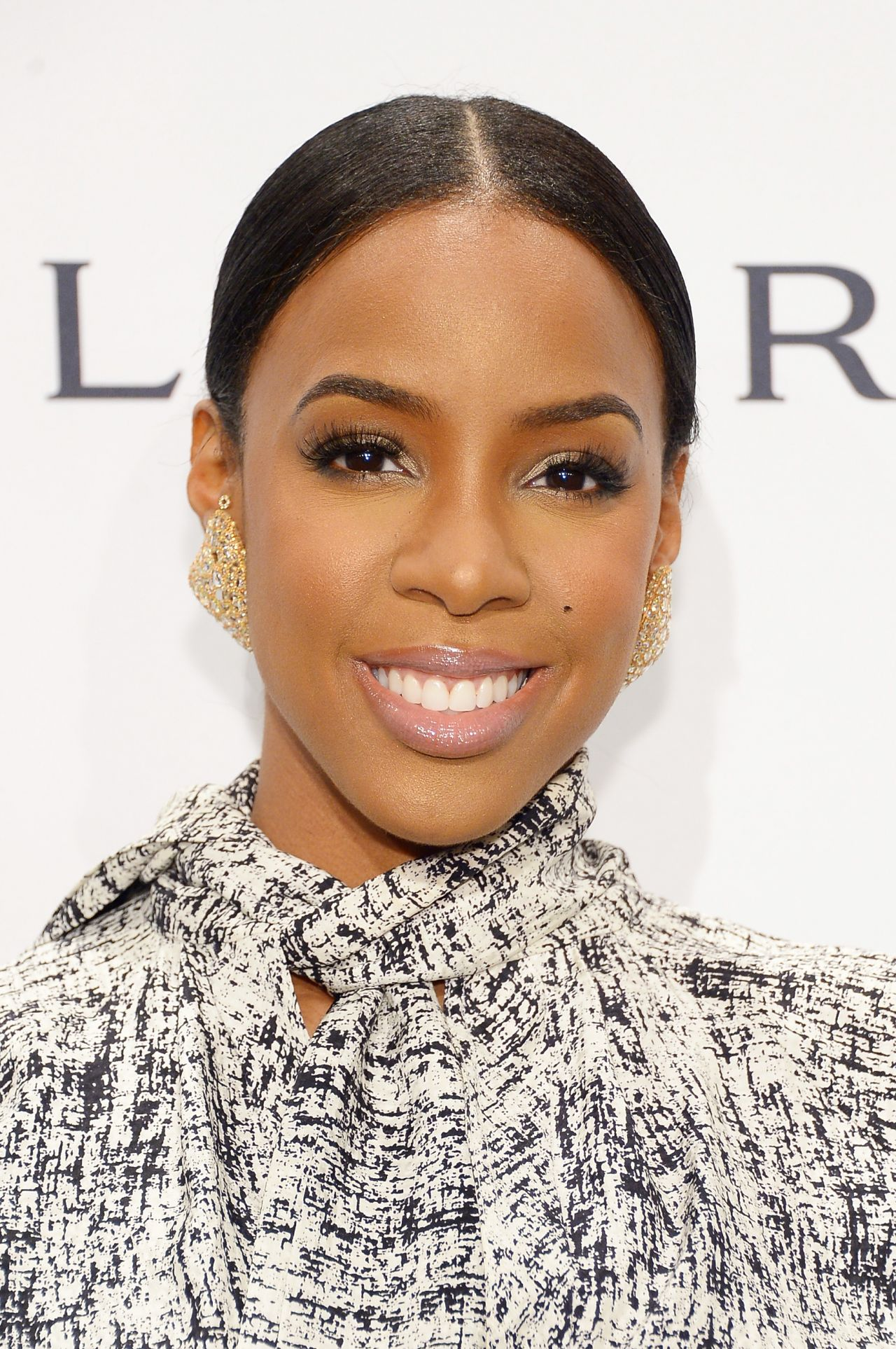 Kelly Rowland  Wearing Juan Carlos Obando Dress at 2014 amfAR New York Gala New York City