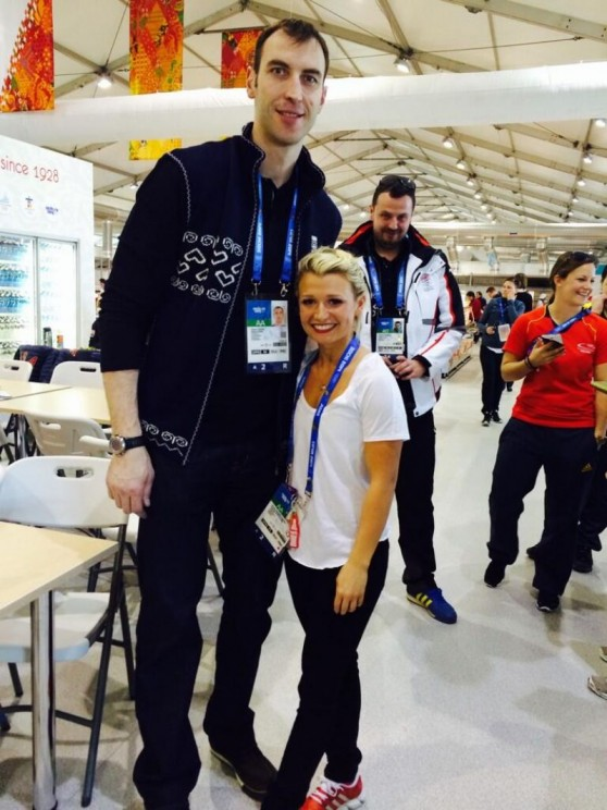"Kirsten Moore-Towers With 6'9"" Zdeno Chara, who is at the games representing Slovakia in men's ice hockey. Kirsten is 4'10""."