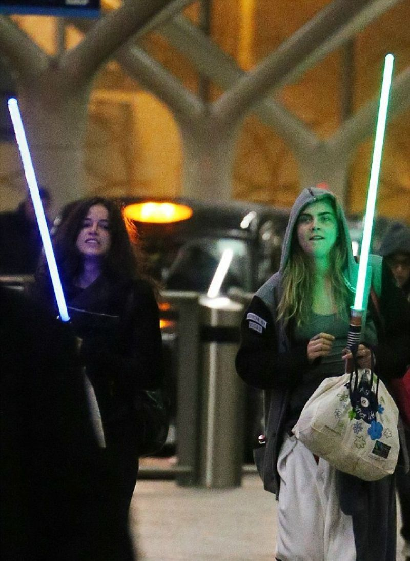 Michelle Rodriguez and Cara Delevingne at London Paddington Station - February 2014
