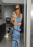 Paris Hilton in a Eye-Catching Outfit - At LAX airport in Los Angeles February 2014