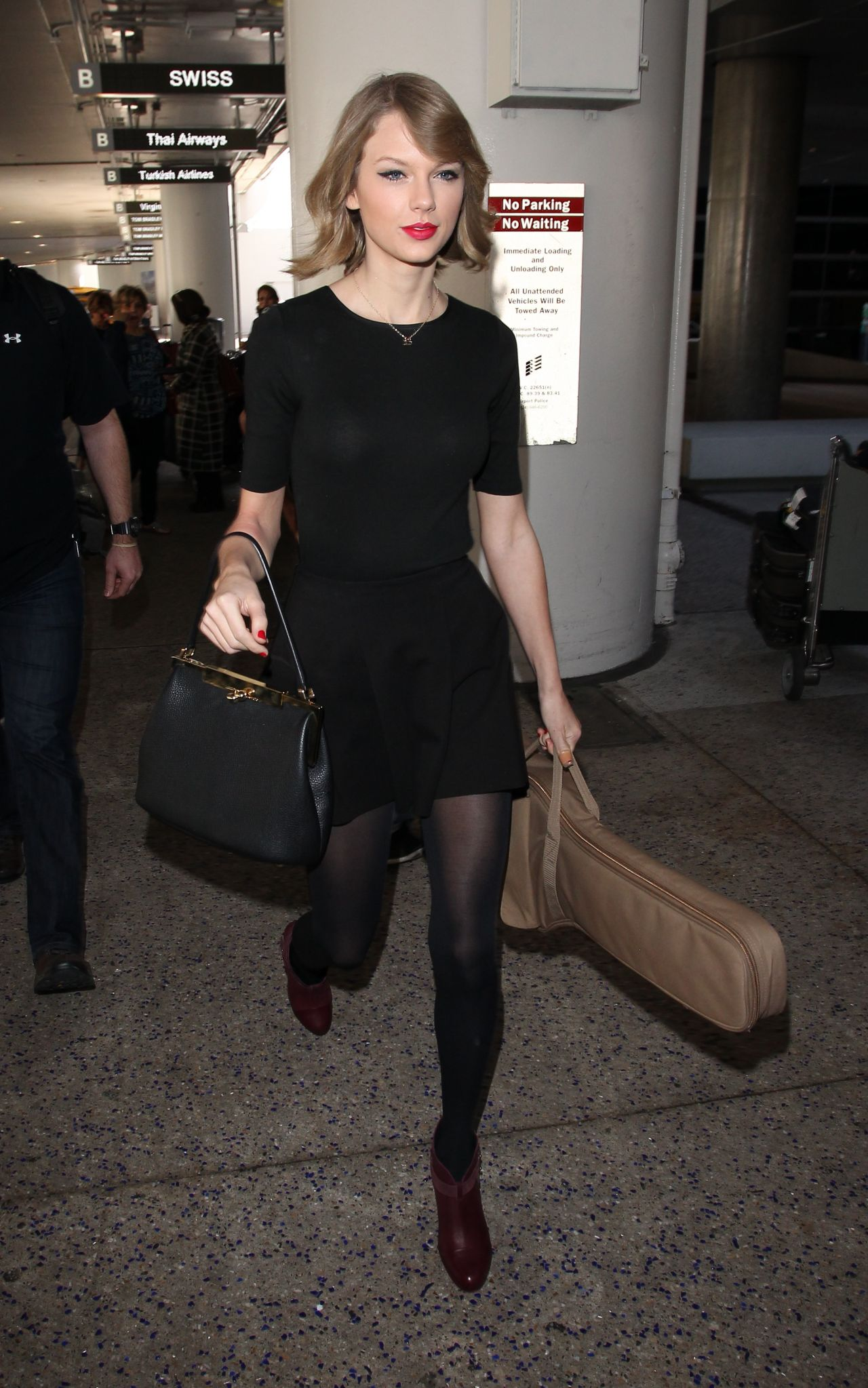 Taylor Swift New Hair Style - LAX Airport - February 2014