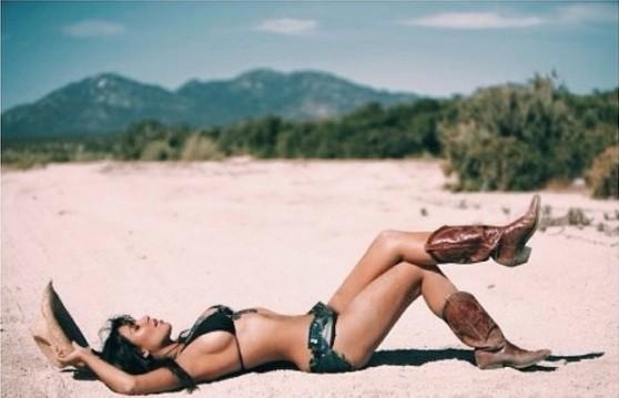 Kim Kardashian as a Bikini Cowgirl in the Sand - Twitter, March 2014