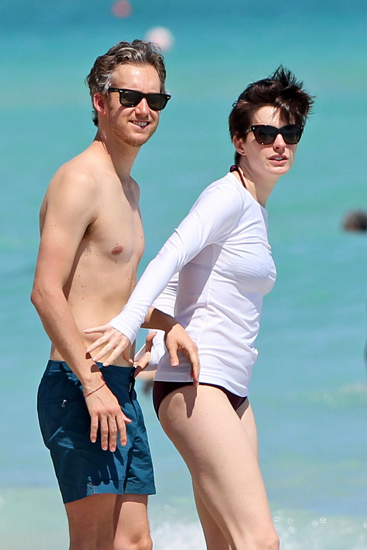 Anne Hathaway in a Covered Bikini, Beach in Miami - March 2014