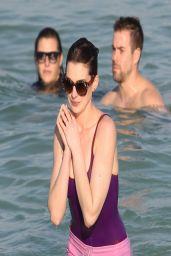 Anne Hathaway in a Swimsuit and Shorts at a Beach in Miami - March 2014