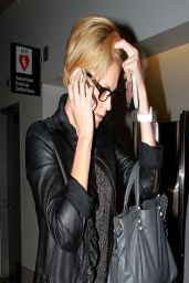 Charlize Theron - Leaving LAX International Terminal - March 2014