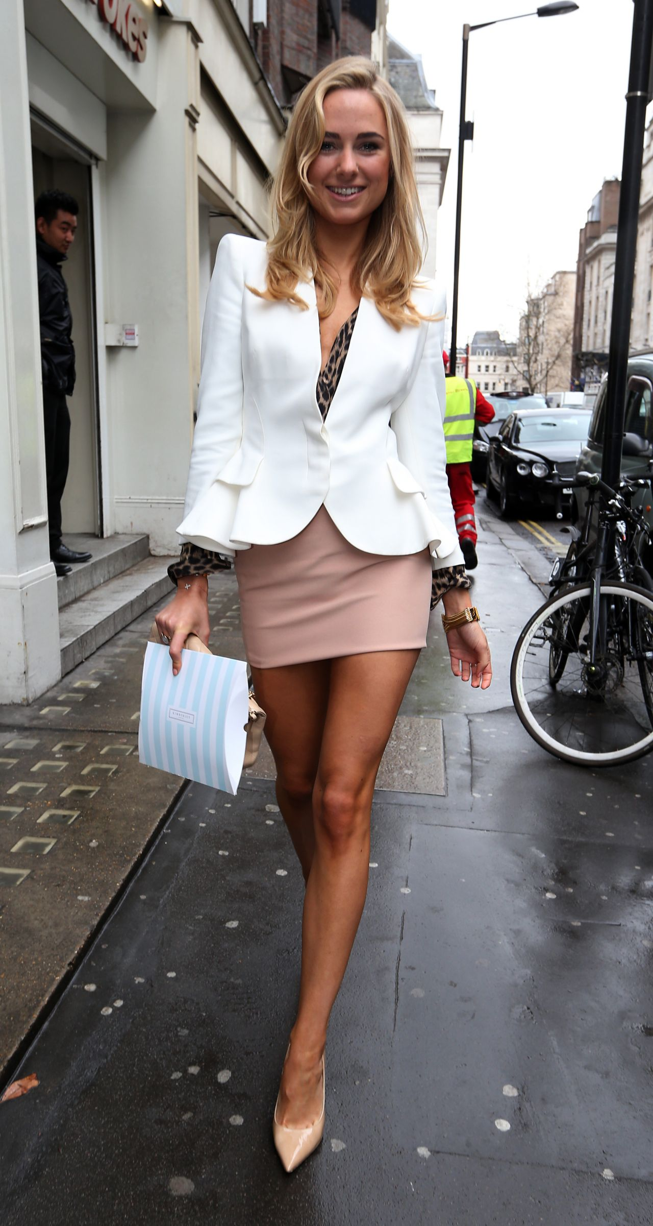 Kimberley Garner Shows Off Her Legs In Biege Minidress