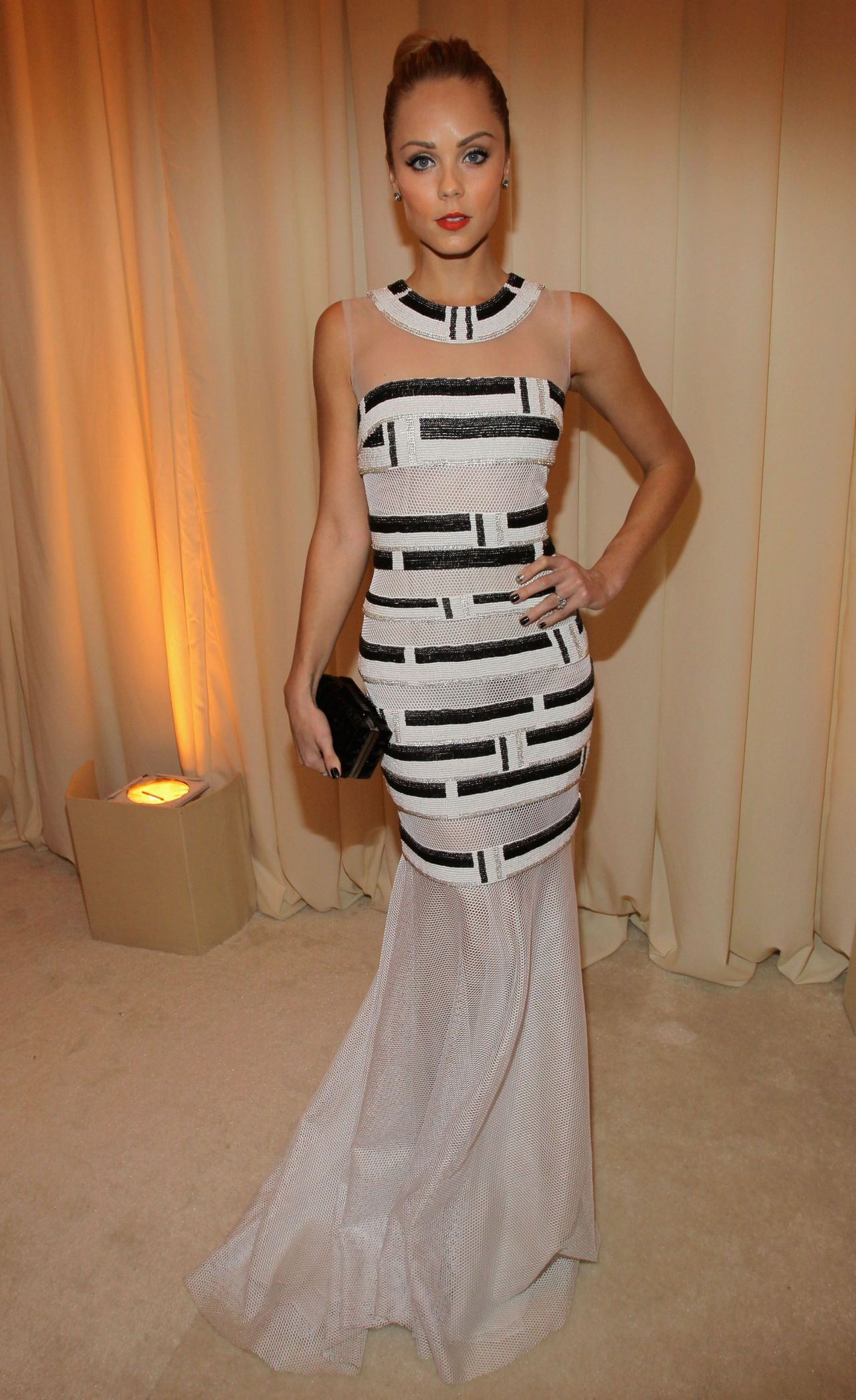 Laura Vandervoort in Carmen Marc Valvo Black and White Fish Tail Gown - 2014 Elton John Oscar Party