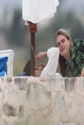 Michelle Rodriguez and Cara Delevingne Cuddle on the Beach - March 2014