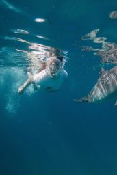 Miranda Cosgrove Oceana Swimming With Dolphins Campaign