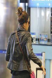 Nina Dobrev - Booty in Tights at LAX Airport - March 2014