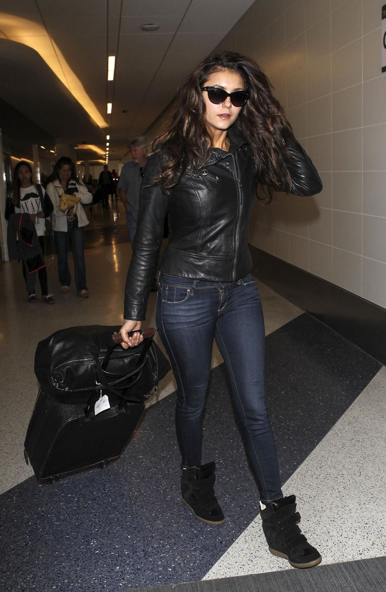 Nina Dobrev in Jeans at LAX Airport - March 2014 • CelebMafia