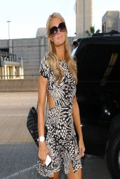 Paris Hilton in Mini Dress - Departing on a Flight at LAX - March 2014