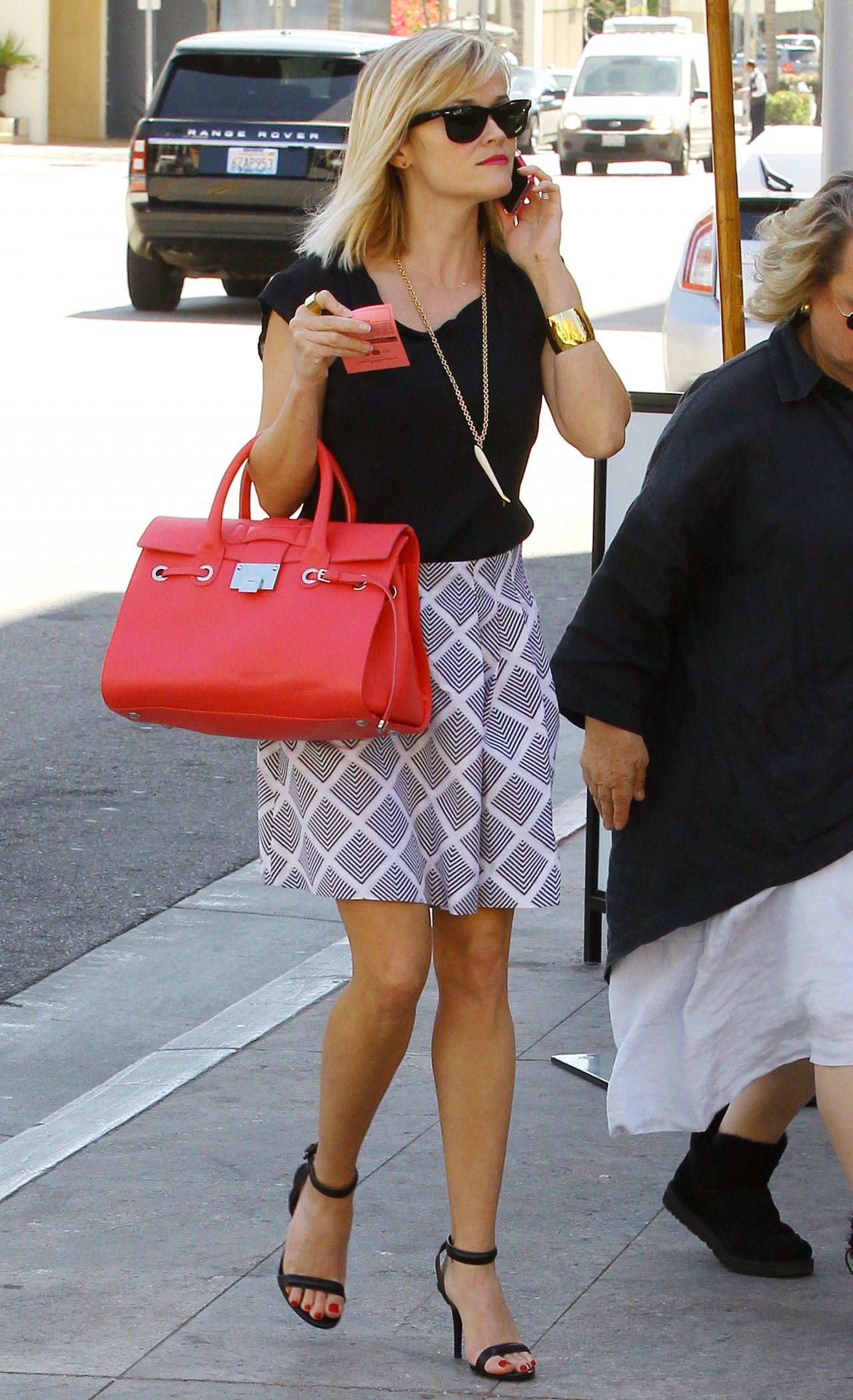 Reese Witherspoon Flaunts Legs in Miniskirt - Bouchon in Beverly Hills - March 2014