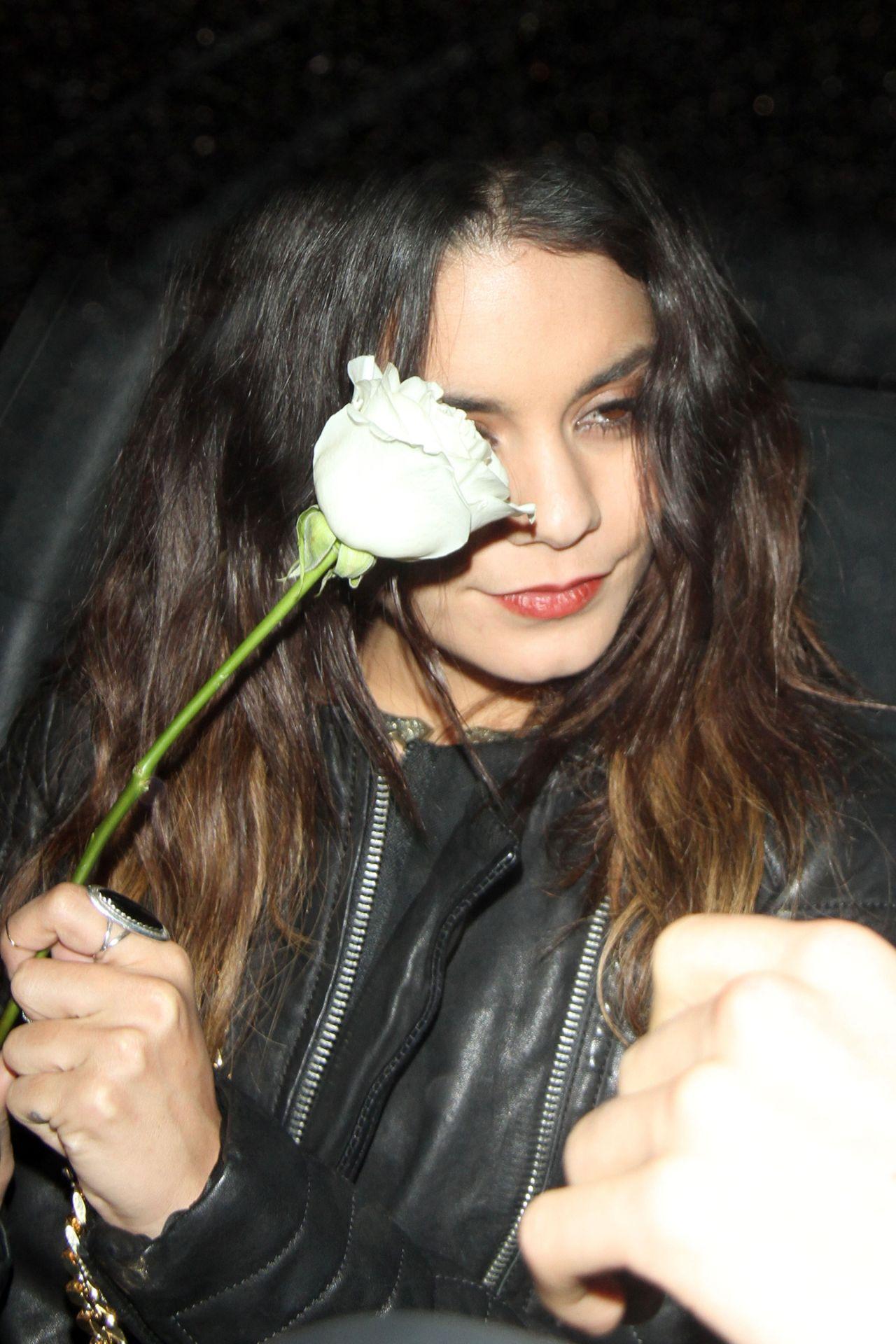 Vanessa Hudgens Carries a White Rose - Laura Vandervoort