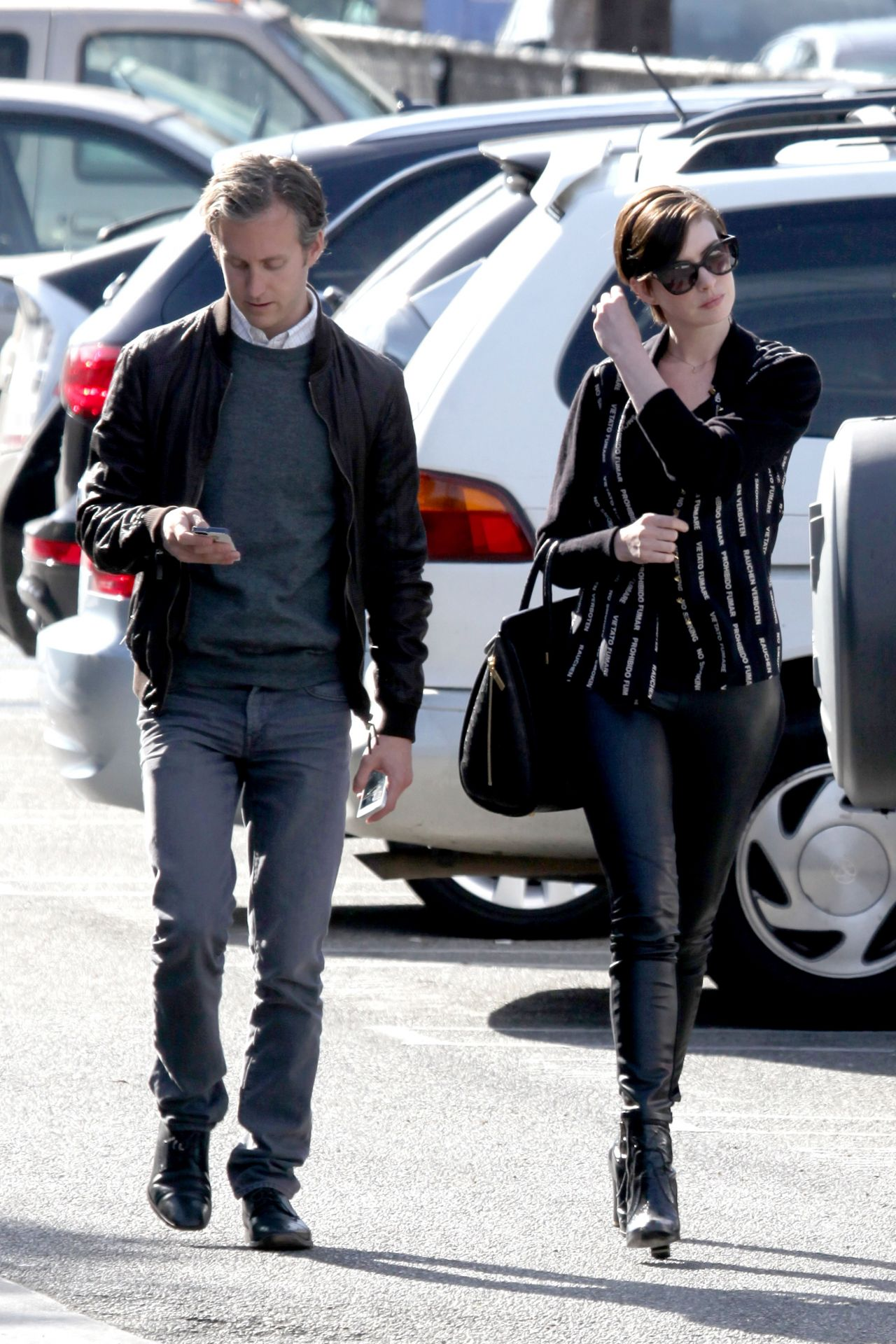 Anne Hathaway shows off toned legs while heading to the