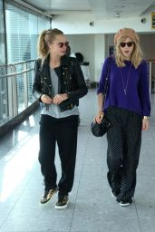 Cara Delevingne and Suki Waterhouse Arrive at Heathrow Airport in London - April 2014