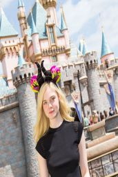 Elle Fanning Posing in a Black Top at Disneyland in Anaheim - April 2014