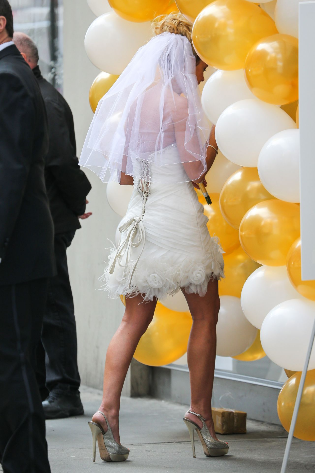 Kate Gosselin Wearing Short Wedding Dress And High Heels