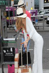 Kimberley Garner at Heathrow Airport in London - April 2014