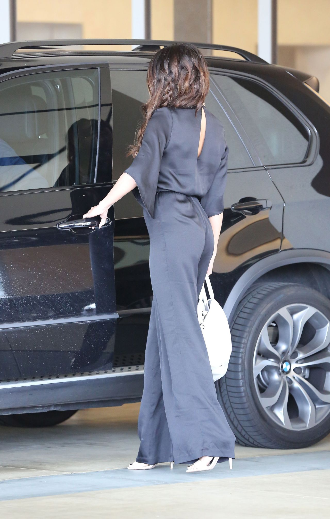 selena gomez in a black silk jumpsuit out in los angeles