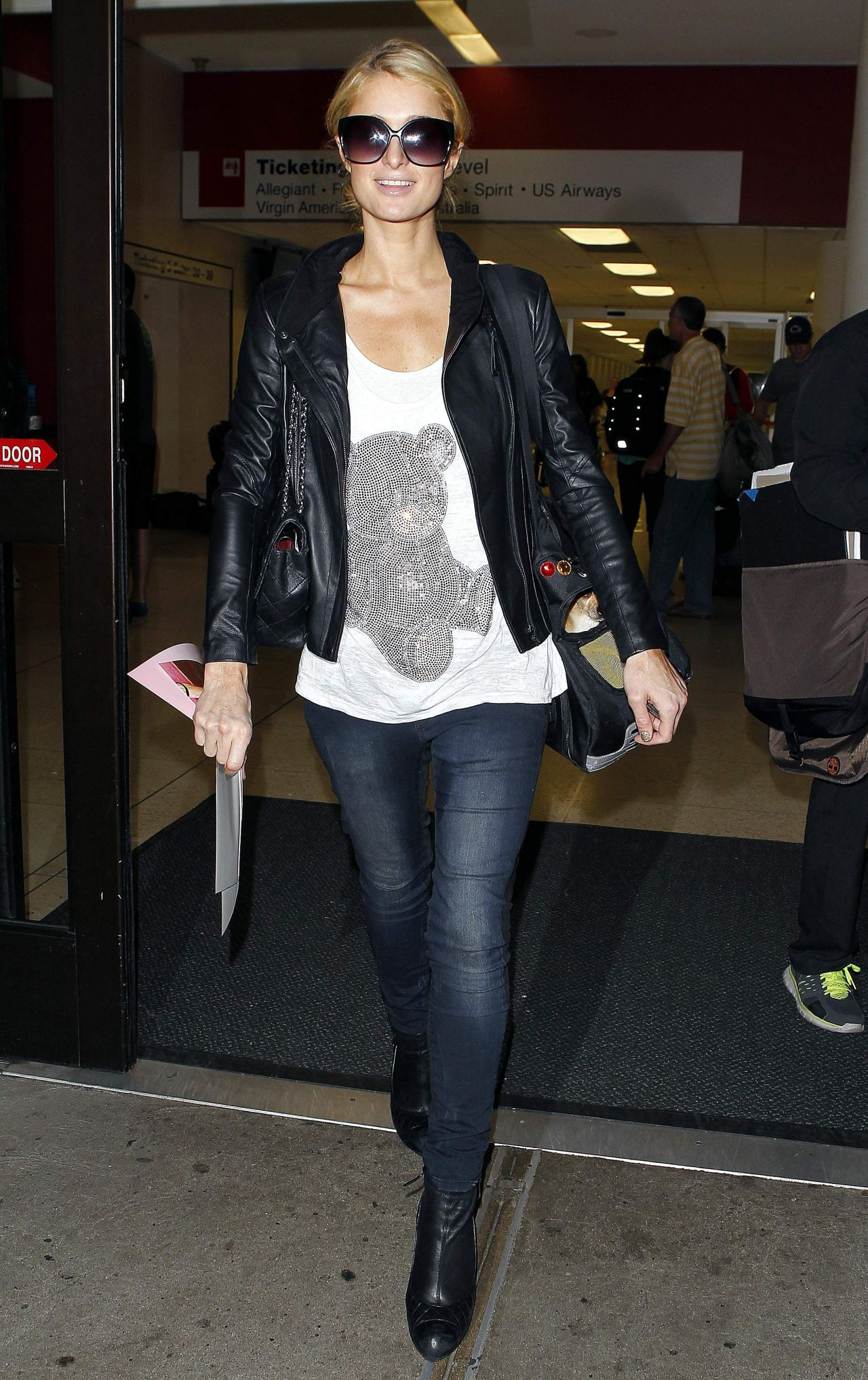 Paris Hilton in Tight Jeans at LAX Airport in Los Angeles - May 2014