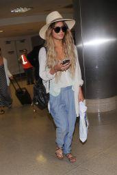 Vanessa Hudgens & Ashley Tisdale at LAX Airport - May 2014