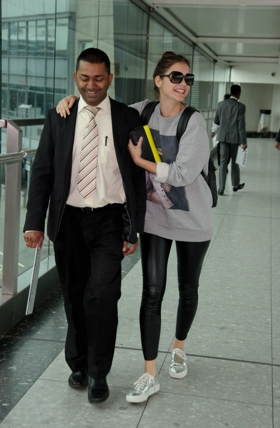 barbara-palvin-looks-cheerful-at-londons-heathrow-airport-june-2014_2