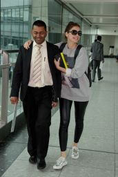 Barbara Palvin Looks Cheerful at Londons Heathrow Airport - June 2014