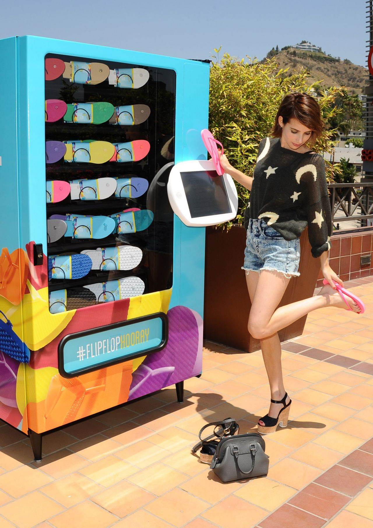 Emma Roberts Snapped Visiting the Old Navy Flip-Flop Vending Machine in Los Angeles - June 2014