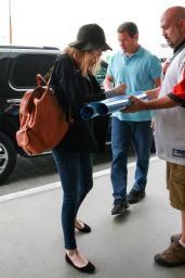 Emma Stone at LAX Airport - June 2014