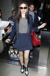 Emmy Rossum in Mini Skirt - LAX Airport in Los Angeles - June 2014