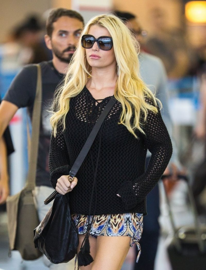 Jessica Simpson in Mini Skirt at LAX & JFK Airport - June 2014